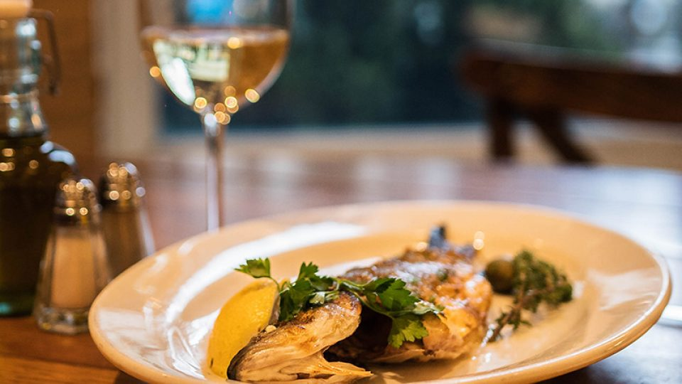 Whole Bronzino Fish with glass of wine